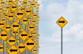 Direction individuality and independent thinking concept as a group of directional arrow traffic signs with one individual pointing in the opposite way as a business icon for innovative solution.