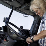 Female trucker in cab